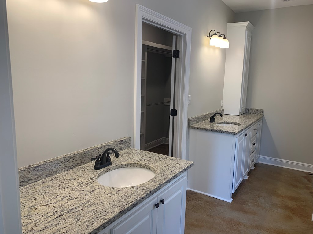 Two separate vanities with granite counter tops  i