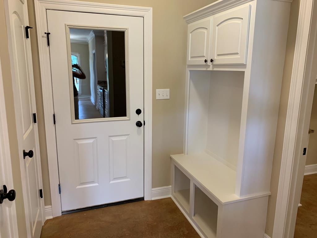 Pantry to the left.  Nook for shoes and coats on t