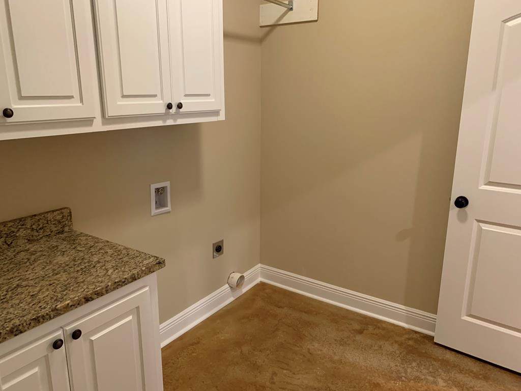 Utility room with door to master closet.